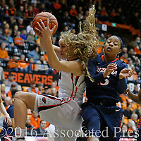 Oregon State's Katie McWilliams, left, grabs a rebound away from Arizona's Keyahndra (cq) Cannon in the first half of an NCAA college basketball game in Corvallis, Ore., on Friday, Jan. 29, 2016. (AP Photo/Timothy J. Gonzalez)