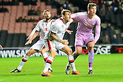 MK Dons defender Kyle McFadzean tussles with Readings Jake Cooper during the Sky Bet Championship match between Milton Keynes Dons and Reading at stadium:mk, Milton Keynes, England on 16 January 2016. Photo by Dennis Goodwin.