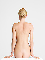 Nude Young Woman sitting back view