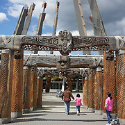The carved contemporary entrance to Te Puia, Rotorua. Te Puia is the premier Maori cultural centre in New Zealand - a place of gushing waters, steaming vents, boiling mud pools and spectacular geysers. Te Puia also hosts National Carving and Weaving Schools and  daily maori culture performances including dancing and singing. Rotorua, 9th December 2010 New Zealand.  Photo Tim Clayton.
