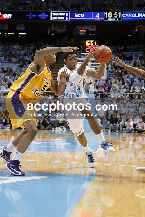 CHAPEL HILL, NC - DECEMBER 15: James Michael McAdoo #43 of the North Carolina Tar Heels dribbles around Ty Armstrong #5 of the East Carolina Pirates on December 15, 2012 at the Dean E. Smith Center in Chapel Hill, North Carolina. North Carolina won 93-87.  *** Local Caption *** James Michael McAdoo;Ty Armstrong