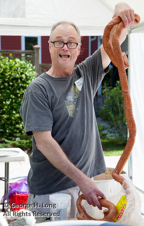 Harry Bruin prepares to cook sausage at the crawfish boil for the North Shore Chapter of Loyola University alumni at the home of George Long and Courtney Blitch in Abita Springs, Louisiana