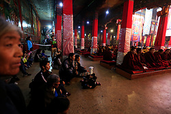 A picture made available on 19 September 2016 of Tibetan pilgrims watching a Buddhist ceremony inside the Sera Monastery in Lhasa, Tibet Autonomous Region, China, 11 September 2016. Sera Monastery is  known as one of the 'great three' Gelug university monasteries of Tibet founded in 1419.