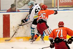 Spannring Patrick of EHC Linz and Ankerst Jaka of HK Jesenice during ice-hockey match between HK Acroni Jesenice and EHC Liwest Black Wings Linz in 43rd Round of EBEL league, on Januar 17, 2012 at Dvorana Podmezaklja, Jesenice, Slovenia. (Photo By Urban Urbanc / Sportida)