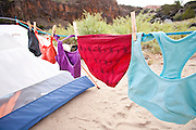 Women's underwear drying on a line stretched between tents in a river runner's camp on the Colorado River in Westwater Canyon, Utah.