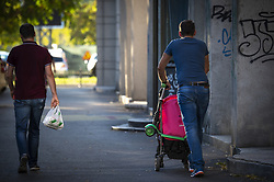 October 7, 2018 - Bucharest, Romania - A man is seen pushing a baby stroller in central Bucharest, Romania on October 7, 2018. A referendum being held this weekend could result in redefining marriage in the constitution from a union between couples to one between a man and a woman. (Credit Image: © Jaap Arriens/NurPhoto/ZUMA Press)