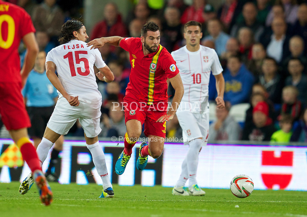 CARDIFF, WALES - Tuesday, September 10, 2013: Wales' Joe Ledley in action against Serbia during the 2014 FIFA World Cup Brazil Qualifying Group A match at the Cardiff CIty Stadium. (Pic by David Rawcliffe/Propaganda)