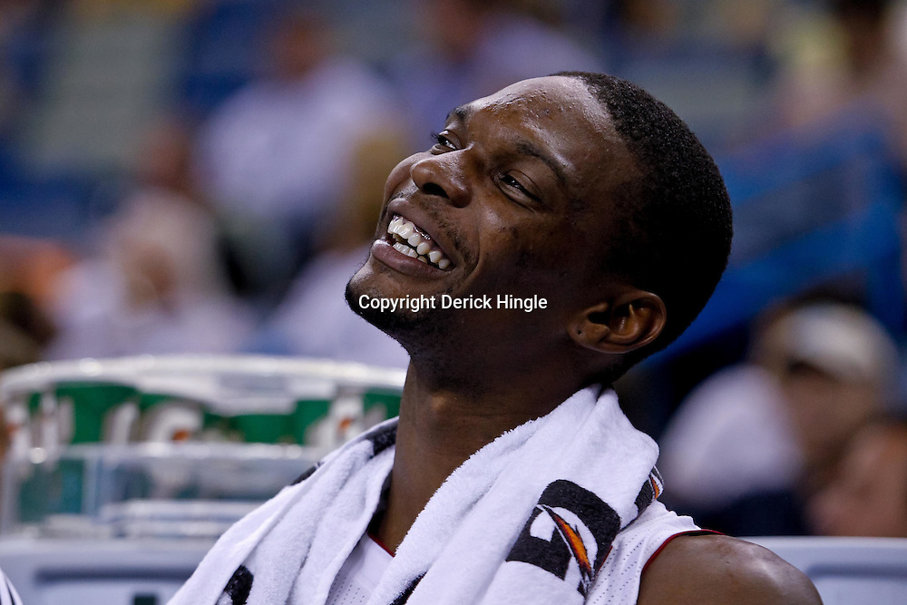 October 13, 2010; New Orleans, LA, USA; Miami Heat power forward Chris Bosh (1) watches from the bench during a preseason game against the New Orleans Hornets at the New Orleans Arena. The Hornets defeated the Heat 90-76. Mandatory Credit: Derick E. Hingle