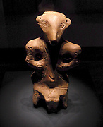 Clay figurine of a person seated wearing a mask. Late Neolithic (4500-4000 BC), from Vinca-Belo Brdo Tell in Serbia