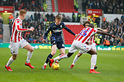 Leeds United forward Jack Clarke (47)  is tackled by Stoke City defender Bruno Martins Indi (15)  during the EFL Sky Bet Championship match between Stoke City and Leeds United at the Bet365 Stadium, Stoke-on-Trent, England on 19 January 2019.
