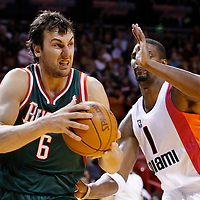 22 January 2012:  Milwaukee Bucks center Andrew Bogut (6) drives past Miami Heat power forward Chris Bosh (1) during the Milwaukee Bucks 91-82 victory over the Miami Heat at the AmericanAirlines Arena, Miami, Florida, USA.