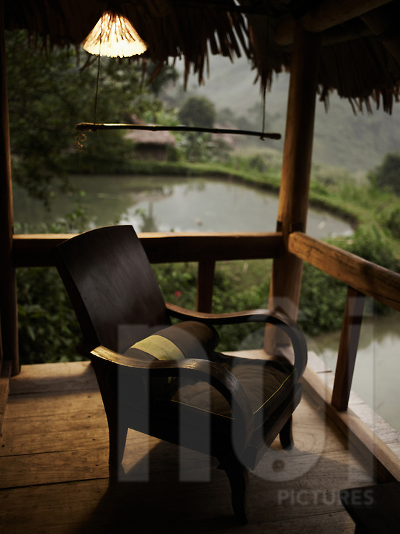 wood chair on a stilt house terrace in Hieu resort, Pu Luong natural reserve, Vietnam, Asia.