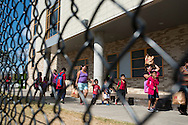 Students leave the Jack Lowe Sr Elementary School in Dallas, Texas on October 1, 2014. (Cooper Neill for The New York Times)