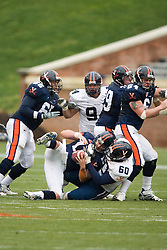 Virginia Cavaliers QB Scott Deke (15) is sacked by DE Kevin Crawford (60).  The University of Virginia Football Team played their Spring game at Scott Stadium in Charlottesville, VA on April 14, 2007.
