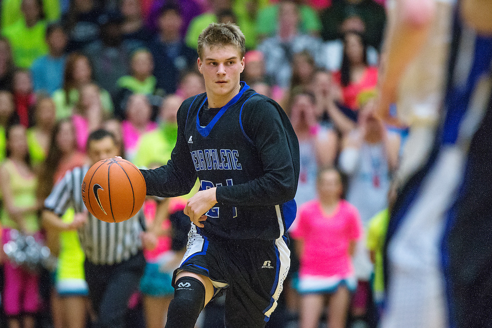 GABE GREEN/Press<br /> <br /> Coeur d&rsquo;Alene junior guard Ryan Walde takes the ball down the court Tuesday at Lake City.
