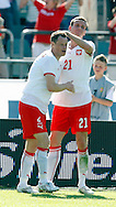 CHORZOW 01/06/2008.POLAND v DENMARK.INTERNATIONAL FRIENDLY.JACEK KRZYNOWEK WITH HIS TEAM MATE TOMASZ ZAHORSKI CELEBRATE THE EQUALISER ..FOT. PIOTR HAWALEJ / WROFOTO