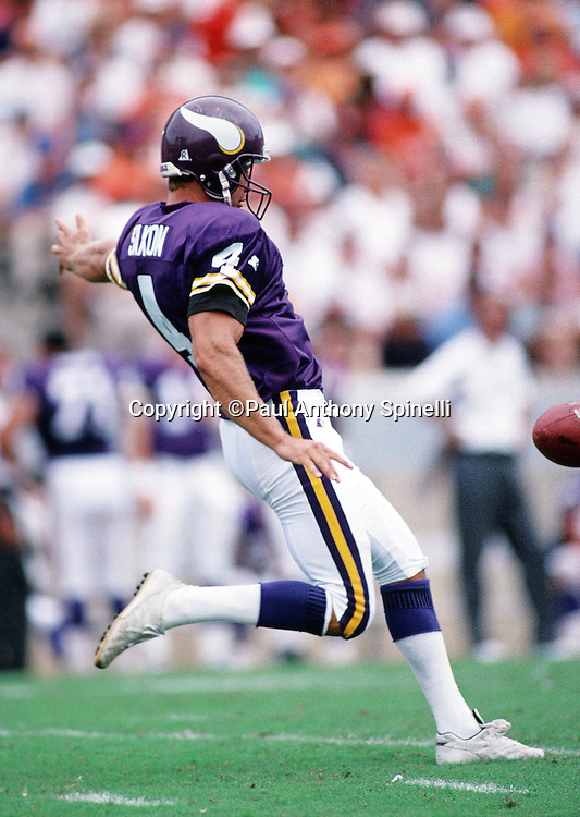 Minnesota Vikings punter Mike Saxon (4) punts during the NFL football game against the Tampa Bay Buccaneers on Oct. 15, 1995 in Tampa, Fla. The Bucs won the game 20-17 in overtime. (©Paul Anthony Spinelli)