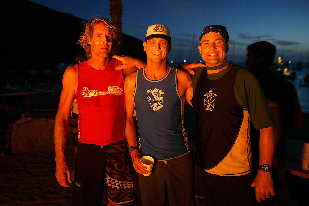 Darrell Bednark and friends stand for a portrait around the fire pit before the Catalina Classic Paddle board race between Two Harbors and the Manhattan Beach Pier on Sunday, August 30, 2015 in Two Harbors, Calif.  Paddlers start from Two Harbors on Catalina Island, traveling 32 miles through the Pacific Ocean in an endurance feat to end at the Manhattan Beach Pier. © 2015 Patrick T. Fallon