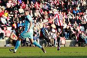 Dan Holman shoots and scores his second during the Vanarama National League match between Cheltenham Town and Boreham Wood at Whaddon Road, Cheltenham, England on 25 March 2016. Photo by Carl Hewlett.