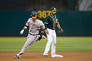 San Francisco Giants shortstop Brandon Crawford (35) rounds second base against the Oakland Athletics at Oakland Coliseum in Oakland, California, on July 31, 2017. (Stan Olszewski/Special to S.F. Examiner)