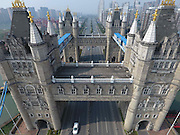 SUZHOU, CHINA - FEBRUARY 25: <br /> <br /> Bridge Resembling London Tower Bridge Built In China<br /> <br /> Cars run across the bridge resembling the London Tower Bridge on February 25 in Suzhou, Jiangsu Province of China. The bridge, built over Yuanhe Pond in Suzhou, insists of four 40-meter-tall towers which resemble the Tower Bridge in London.<br /> ©Exclusivepix Media