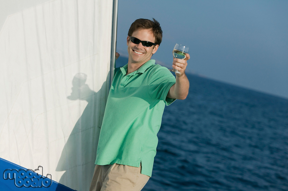Man on Sailboat with Glass of Wine