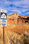 Morning light on The Castle and Highway 24/Scenic Byway road sign, Capitol Reef National Park, Utah