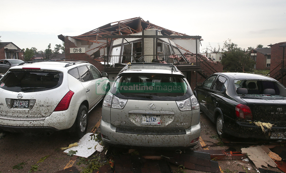 May 23, 2019 - St. Louis, MO, USA - Shattered windows and roofless apartment buildings dotted the Hawthorne Park apartments in Jefferson City after a tornado ripped through their complex on Thursday, May 23, 2019. (Credit Image: © TNS via ZUMA Wire)