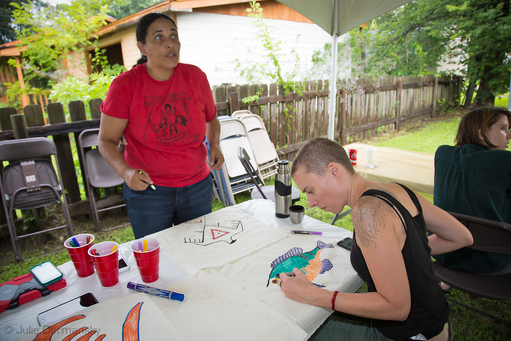 Cherri Foytlin gets the artwork going at an art build even in St. James, LA..Art build for L'eau Est La Vie Camp organized by Bold Louisiana for the St. James community in St. James where the Bayou Bridge will end, if it is not stopped.
