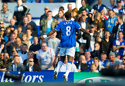 LIVERPOOL, ENGLAND - Sunday, September 20, 2009: Everton's Louis Saha celebrates scoring the opening goal against Blackburn Rovers during the Premiership match at Goodison Park. (Pic by David Rawcliffe/Propaganda)