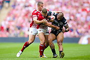 Hull FC second row Sika Manu (21) is tackled by Wigan Warriors stand off George Williams (6) during the Ladbrokes Challenge Cup Final 2017 match between Hull RFC and Wigan Warriors at Wembley Stadium, London, England on 26 August 2017. Photo by Simon Davies.
