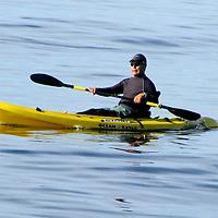 A man paddles past the Santa Monica Pier on his Ocean Kayak Scrambler on Friday, December 24, 2010.