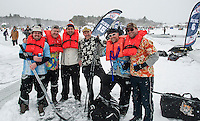 "The ""Backyard Ice"" team (Shinny 35+ division)  arrives with a sense of humor and their life jackets for their first game with the HFD Flatlanders during day one of the New England Pond Hockey Classic on Lake Waukewan Friday.  (l-r) Chet Warsheski, Chris Davison, Brent Squires, Andy Johnson, Alex Rogo and Tim Davison.  (Karen Bobotas/for the Laconia Daily Sun)"
