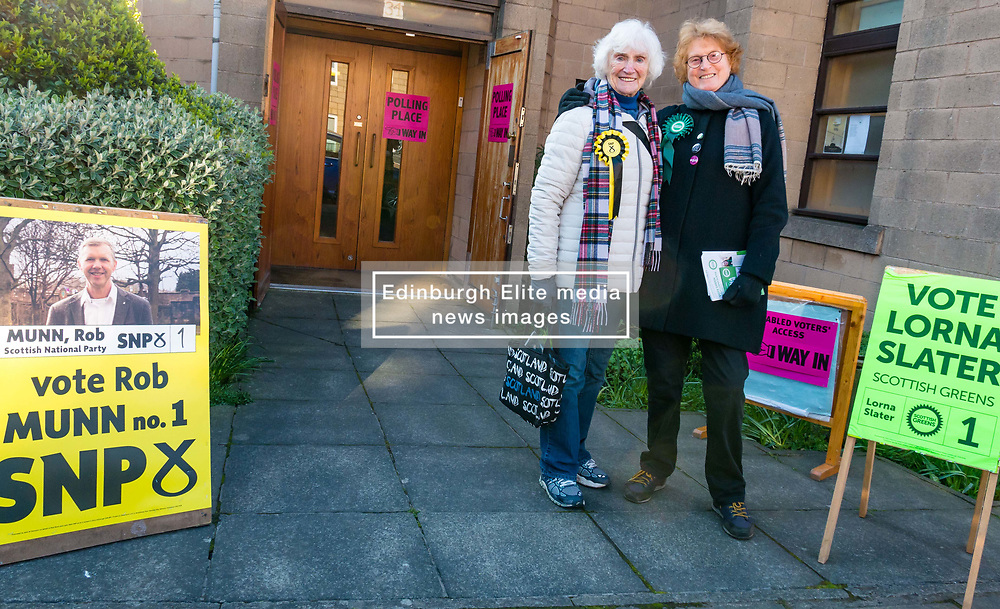 Leith, Edinburgh, Scotland, United Kingdom, 11 April 2019. Leith Walk Council By-Election: Isabelle, SNP activist for 70 years, and Caro, Scottish Greens activist, outside one of the polling stations at Ebenezer United Free Church. Voting is slow this morning with only a dozen vaoters arriving by 8.30am. The election is taking place as a result of the resignation of Councillor Marion Donaldson. The election fields 11 candidates, including the first ever candidate for the For Britain Movement in Scotland, Paul Stirling. The For Britain Movement was founded by former UKIP leadership candidate Anne Marie Waters in March 2018.  <br /> <br /> Sally Anderson/ Edinburgh Elite Media