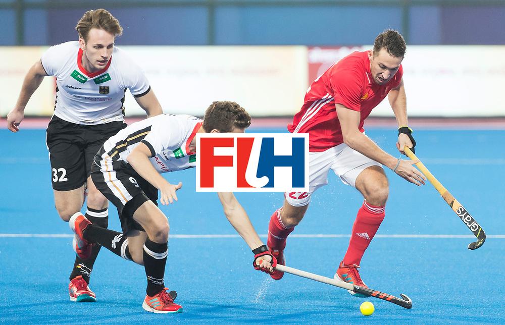 BHUBANESWAR - The Odisha Men's Hockey World League Final . Match ID 01 . Germany v England. David Condon (Eng) with Johannes Grosse (Ger) . left Niklas Bruns (Ger).  WORLDSPORTPICS COPYRIGHT  KOEN SUYK