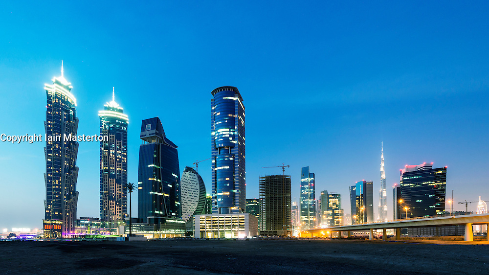 Futuristic skyline at night of new skyscrapers at Business Bay in Dubai United Arab Emirates