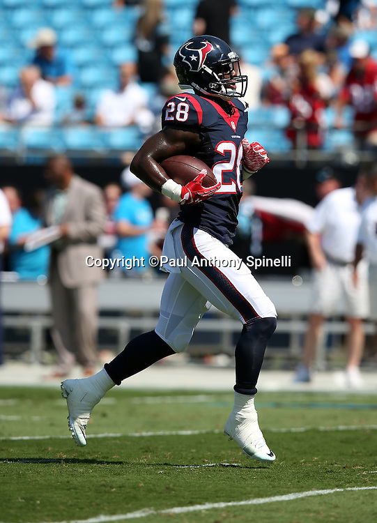 Houston Texans running back Alfred Blue (28) runs with the ball while warming up before the 2015 NFL week 2 regular season football game against the Carolina Panthers on Sunday, Sept. 20, 2015 in Charlotte, N.C. The Panthers won the game 24-17. (©Paul Anthony Spinelli)