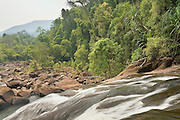 Upi Guling waterfall along the jasin River in Endau-Rompin National Park, Malaysia. This humid jungle is one of the world's oldest rainforest.  It has survived, untouched by the ice ages, for 130 million years.