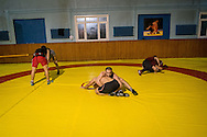 Ahmet Kiliç, centre, trains with a friend during a training sessions held for both professional and hobbyist wrestlers in Istanbul. Haydarpaşa Demirspot Kulbübü