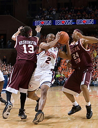 Virginia Cavaliers guard J.R. Reynolds (2) drives past Virginia Tech Hokies forward Deron Washington (13) and Virginia Tech Hokies Markus Sailes (24).  The Virginia Cavaliers Men's Basketball Team defeated the Virginia Tech Hokies 69-56 at the John Paul Jones Arena in Charlottesville, VA on March 1, 2007.