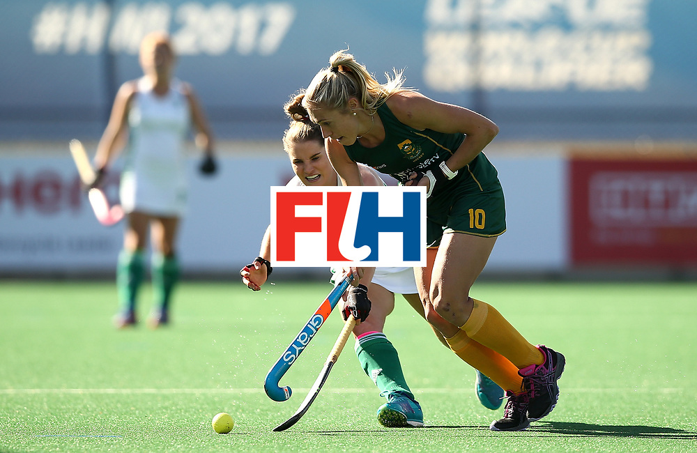 JOHANNESBURG, SOUTH AFRICA - JULY 20:  Shelley Jones of South Africa controls the ball from Emily Beatty of Ireland during the 5th/ 8th place play-off match between South Africa and Ireland at Wits University on July 20, 2017 in Johannesburg, South Africa.  (Photo by Jan Kruger/Getty Images for FIH)