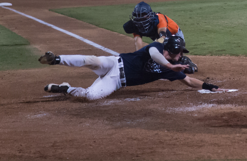 Cypress player 44 Garrett Calvert sides home off of base hit. At California State university Fullerton on Friday November 4 2016