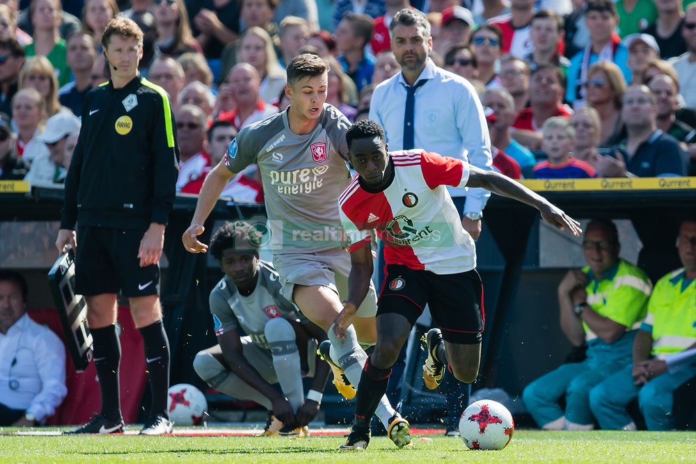 (L-R) Alexander Laukart of FC Twente, Ridgeciano Haps  of Feyenoord during the Dutch Eredivisie match between Feyenoord Rotterdam and FC Twente at the Kuip on August 13, 2017 in Rotterdam, The Netherlands