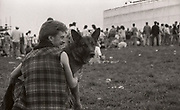 Man and dog at the first outdoor rave up North, The Gio Goi Joy Rave run by Anthony and Chris Donnelly, Ashworth Valley, Rochdale, 5th August 1989.