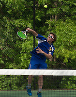Keaton Quigley of Gilford serves the ball to Evan Alfano of Bow during singles boys tennis Tuesday afternoon.  (Karen Bobotas/for the Laconia Daily Sun)