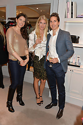 Left to right, DAISY HARRISON, LENA MICHELIN and ALEX MICHELIN at a party at Herve Leger, Lowndes Street, London on 12th November 2014 to view the latest collection.