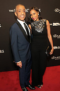 8 February -Washington, D.C: (L-R) Rev. Al Sharpton and Stylist Aisha McShaw attends the BET Honors 2014 Red Carpet held at the Warner Theater on February 8, 2014 in Washington, D.C.  (Terrence Jennings)