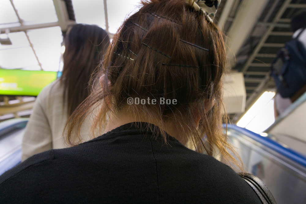 female commuter with hairpins still in