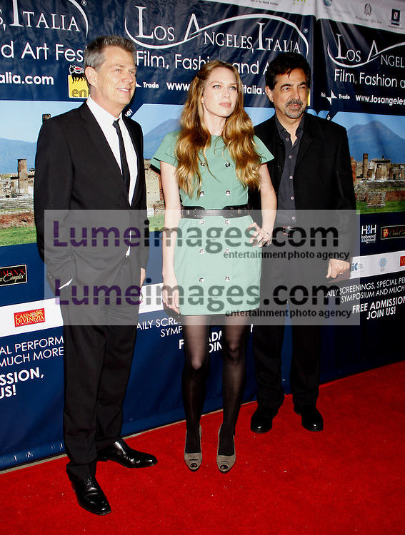 HOLLYWOOD, CA - MARCH 01, 2010: David Foster, Erin Foster and Joe Mantegna at the Los Angeles premiere of 'Andrea Bocelli The Story Behind the Voice' held at the Grauman's Chinese Theater in Hollywood, USA on March 1, 2010.