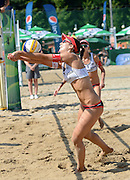 STARE JABLONKI POLAND - July 3: Romana Kayser /1/ and Muriel Graessli of Switzerland in action during Day 3 of the FIVB Beach Volleyball World Championships on July 3, 2013 in Stare Jablonki Poland.  (Photo by Piotr Hawalej)